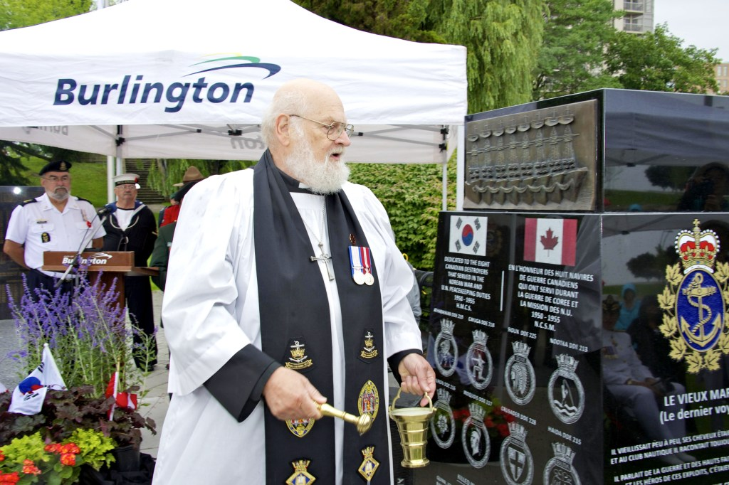 Canon Thomas blessing the Monument